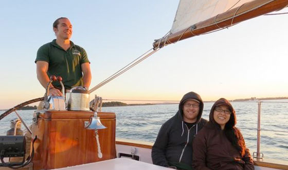Couple sailing on Schooner Adirondack III for a sunset sail in Boston Harbor