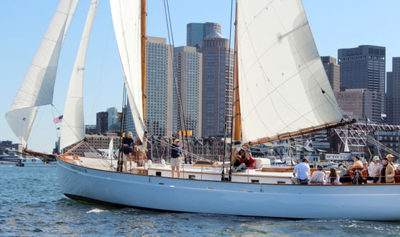 Schooner Adirondack III sailing in Boston Harbor with the Boston Skyline as the background