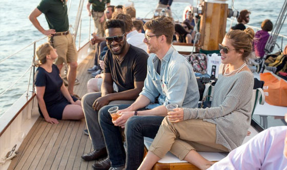 Employees at their company party aboard the Schooner Adirondack III in Boston Harbor