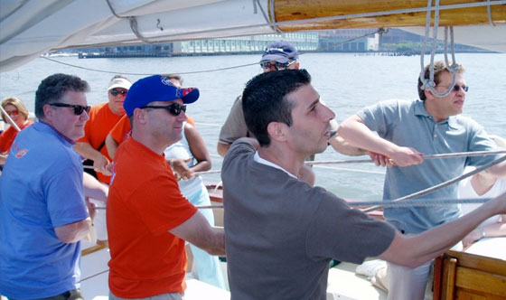 Employees participating in a teambuilder event on the Schooner Adirondack III in Boston Harbor with Classic Harbor Line